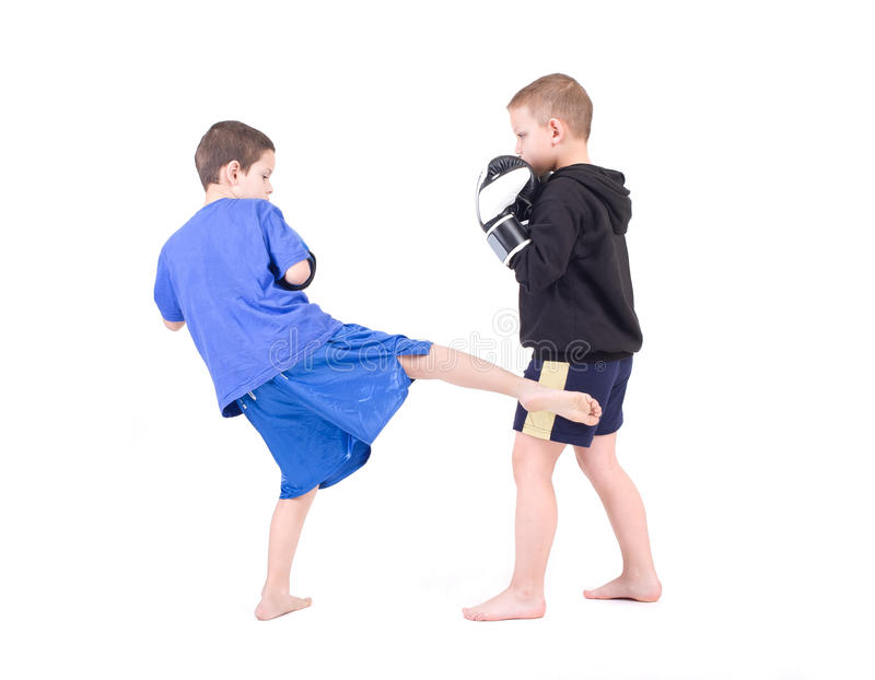 Kids Kickboxing Fight. Isolated on a white background. Studio shot royalty free stock photos