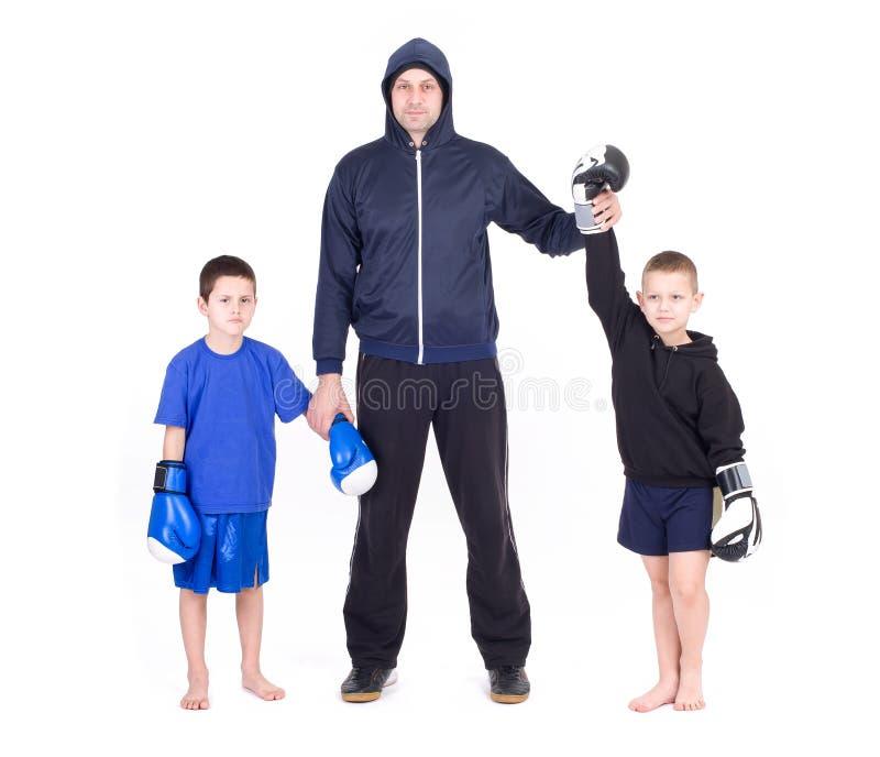Kids Kickboxing Fight. Isolated on a white background. Studio shot stock photo