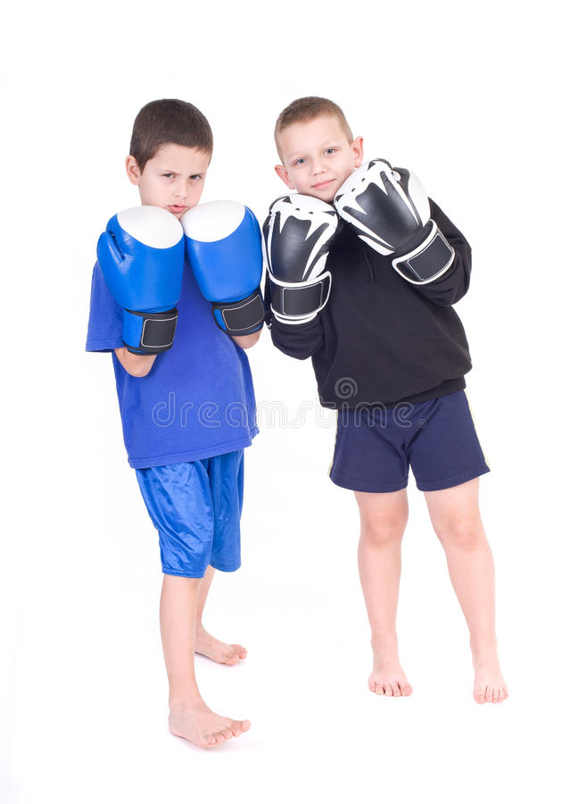Kids Kickboxing Fight. Isolated on a white background. Studio shot royalty free stock photo