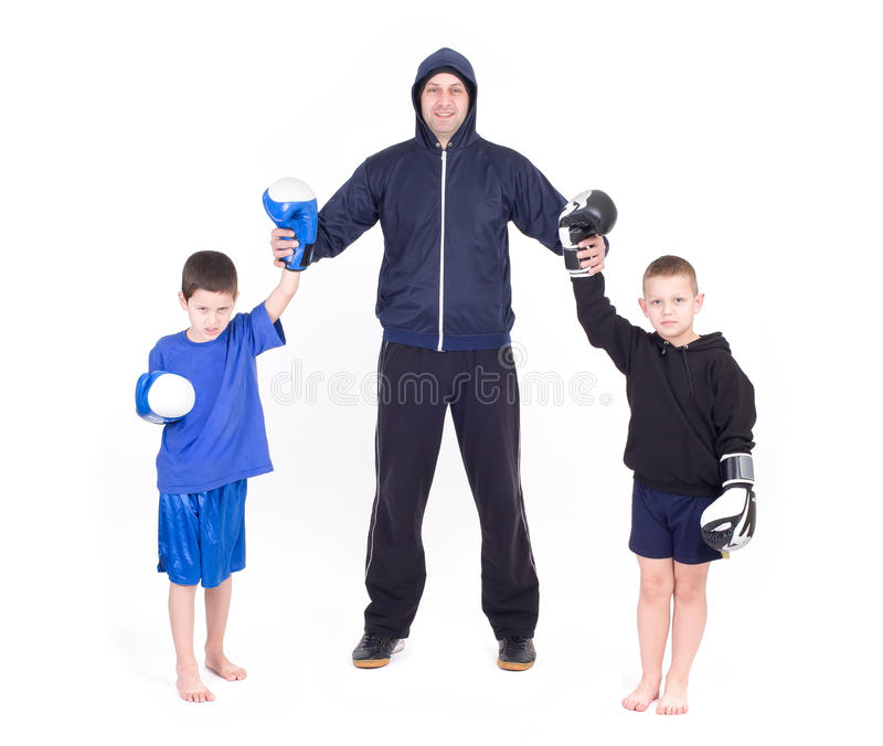 Kids Kickboxing Fight. Isolated on a white background. Studio shot royalty free stock image
