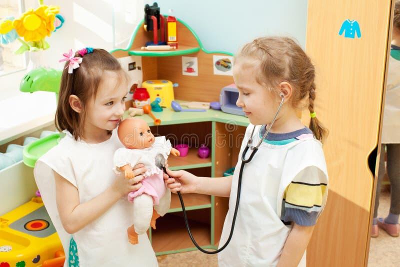 Kids in kindergarten stock photos