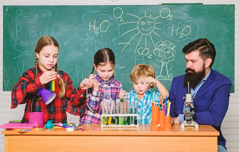 Kids in lab coat learning chemistry in school laboratory. chemistry lab. happy children teacher. back to school. making royalty free stock photos