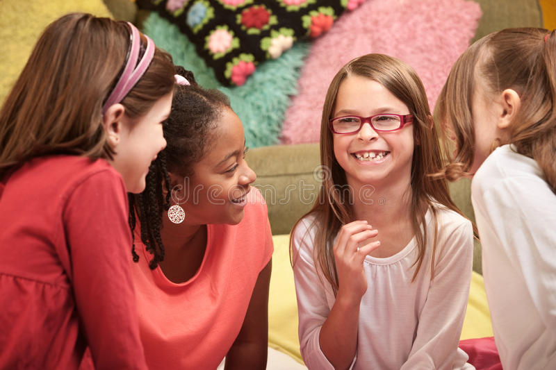 Kids Laughing. Group of four little girls laugh at a sleepover royalty free stock images