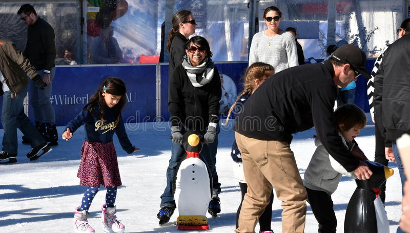 Kids learning to skate on the ice rink at Hyde Park royalty free stock photography