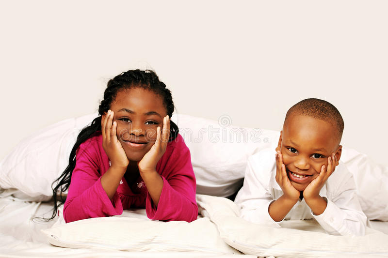 Kids listening to bedtime story royalty free stock photos