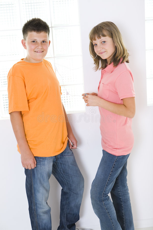 Kids listening to mp3 stock image