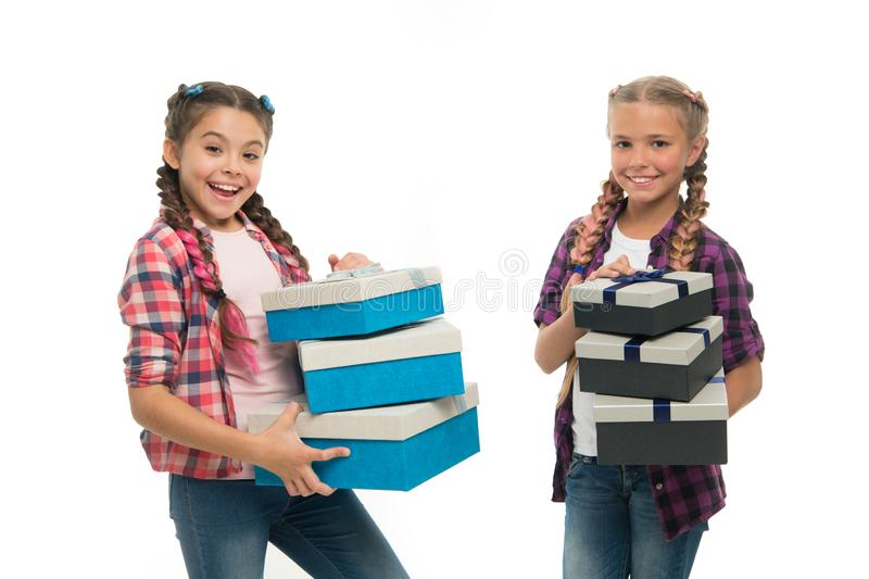 Kids little girls with braids hairstyle hold piles gift boxes. Children excited about unpacking gifts. Small girls stock photos