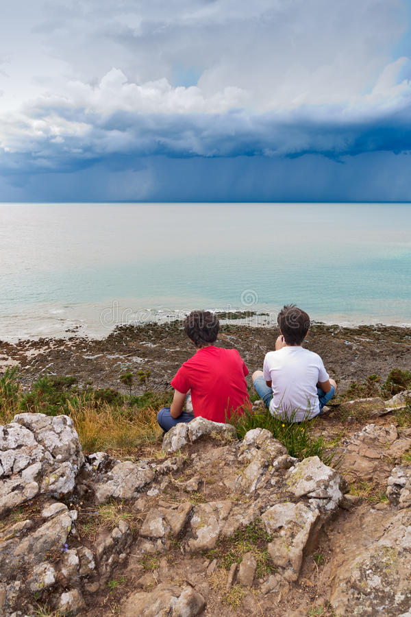 Download Kids Looking at a Storm stock photo. Image of normandy - 26556650
