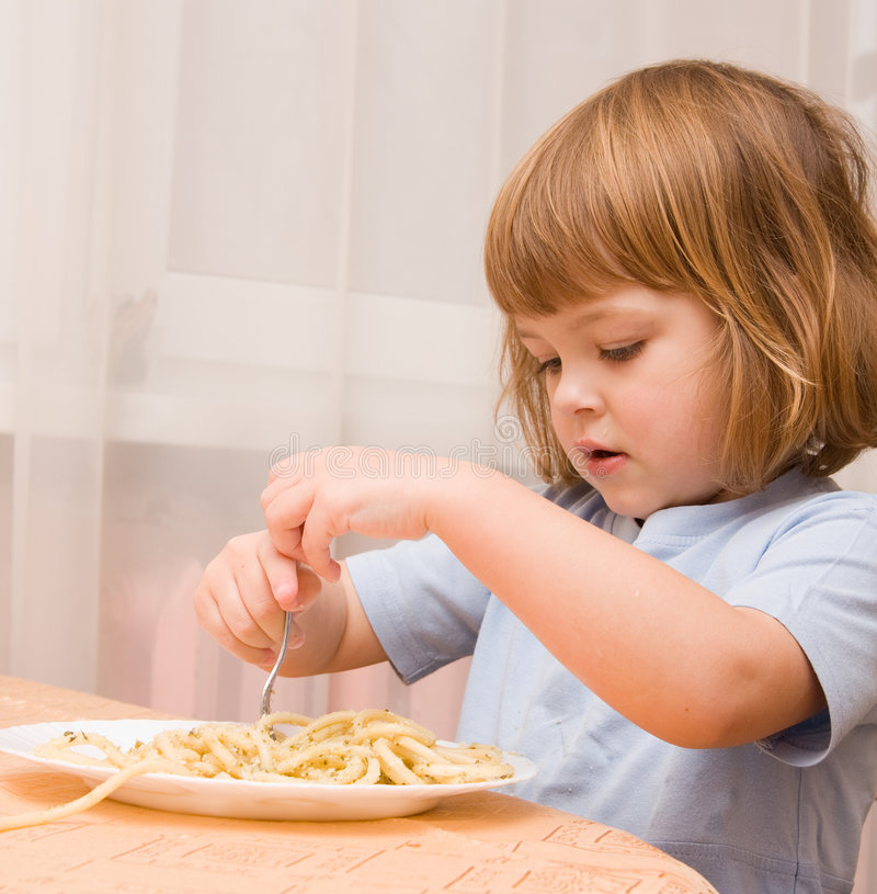 Kids love pasta stock photography