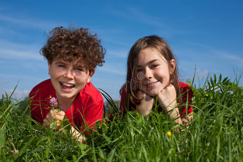 Download Kids lying outdoor stock image. Image of down, grass - 10985217