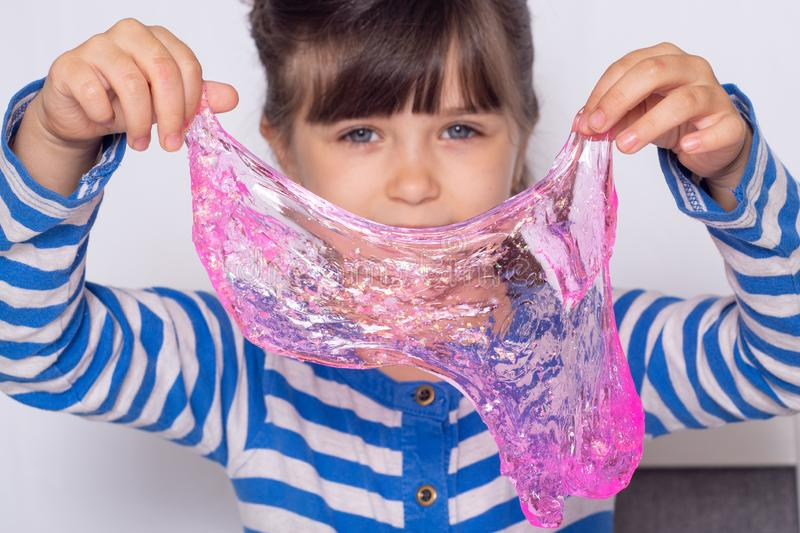 Kids making bubbles slime. Kid playing with slime royalty free stock photography