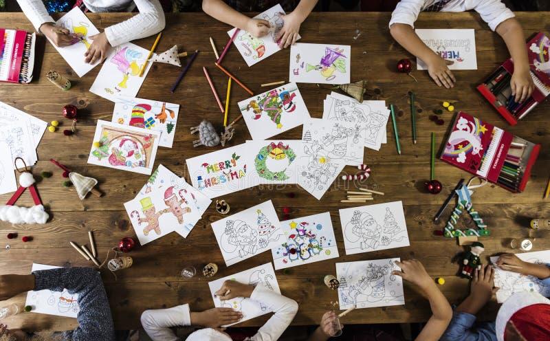 Kids making Christmas cards stock photos