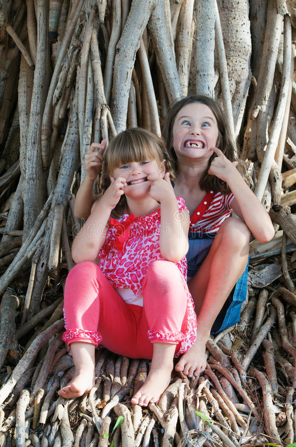 Kids making funny faces stock photo