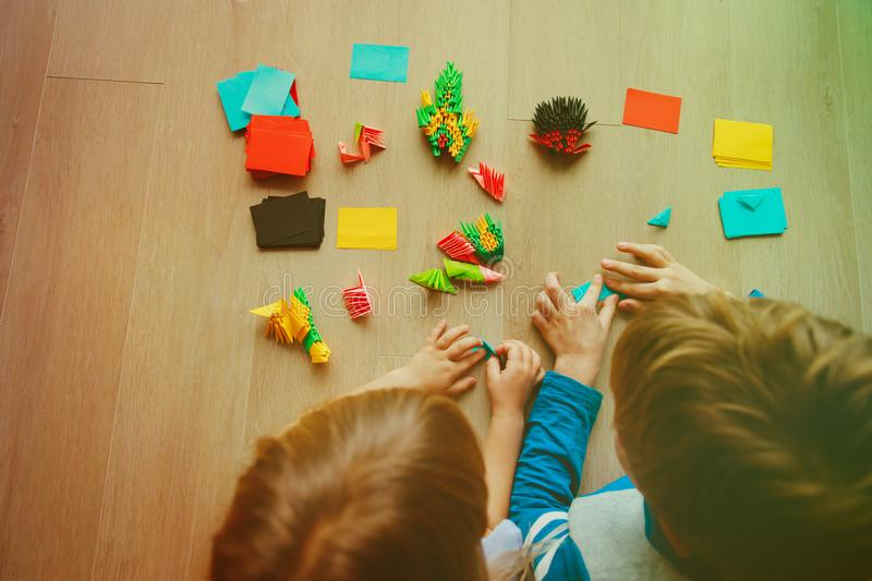 Download Kids Making Origami Crafts With Paper Stock Image