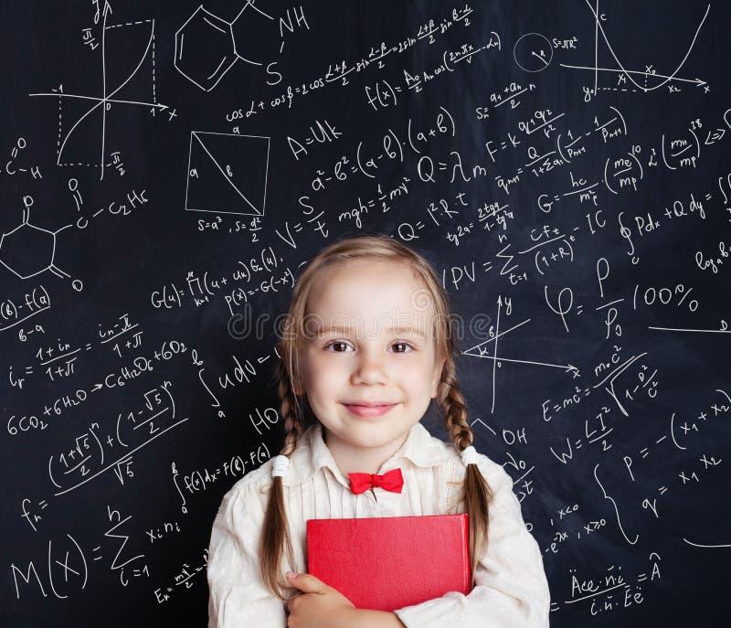Kids mathematics education concept. Happy little girl royalty free stock photo