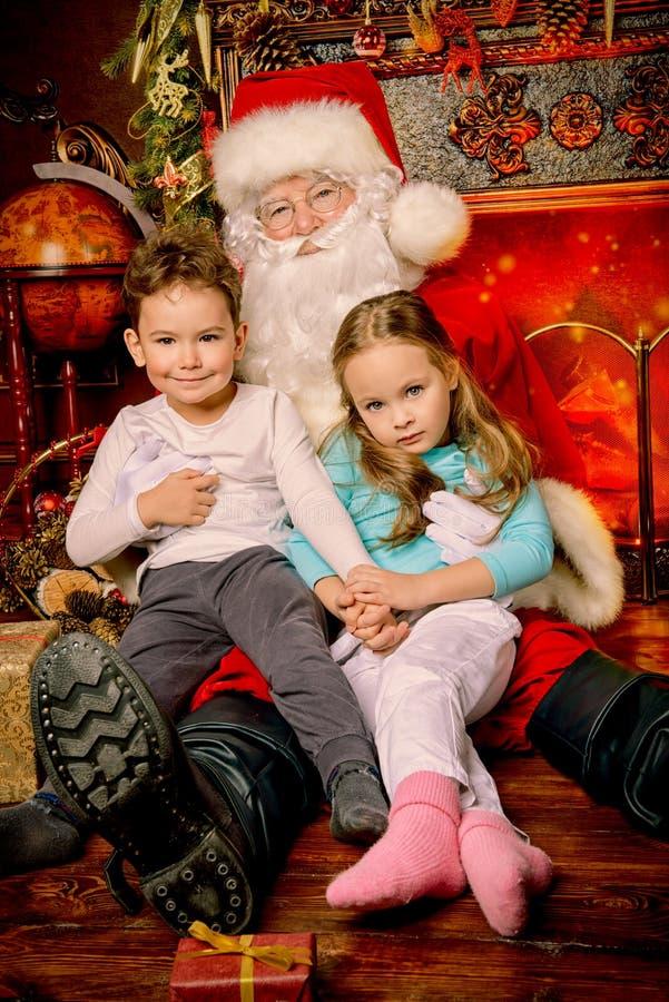 Kids meet Santa stock photos