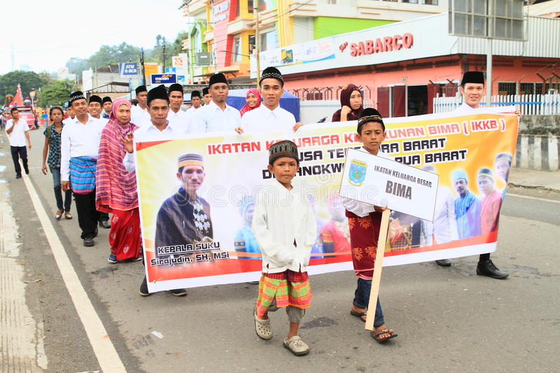Kids, men and women from Bima. Muslim kids, men and women from Bima dressed in traditional clothes and holding signs in procession in occasion of celebration of royalty free stock photography