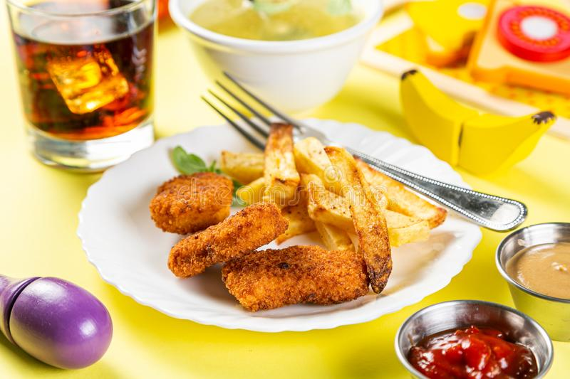Kids menu concept - pasta, nuggets, french fries, soups, cola stock photos