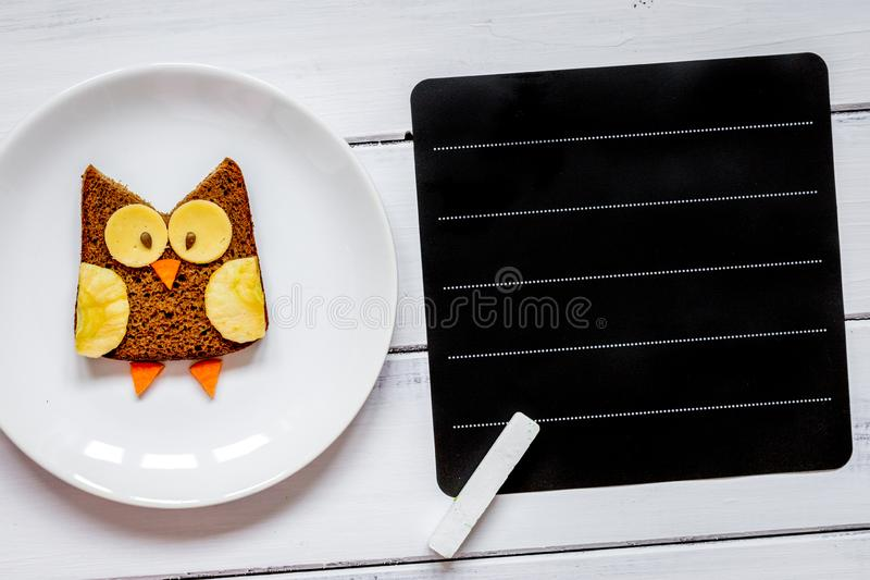 Kids menu owl shaped sandwich place for text top view stock photos