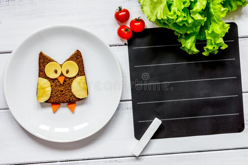Kids menu owl shaped sandwich place for text top view stock photography