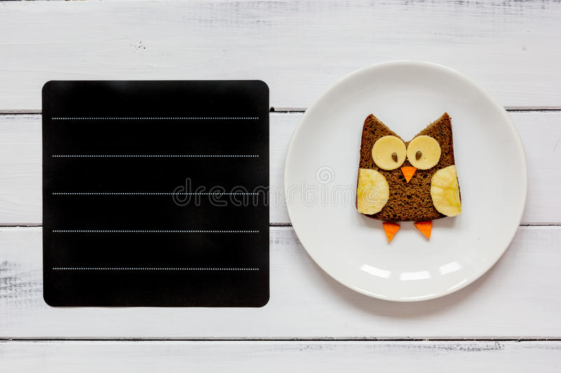Kids menu owl shaped sandwich place for text top view. At wooden background royalty free stock images