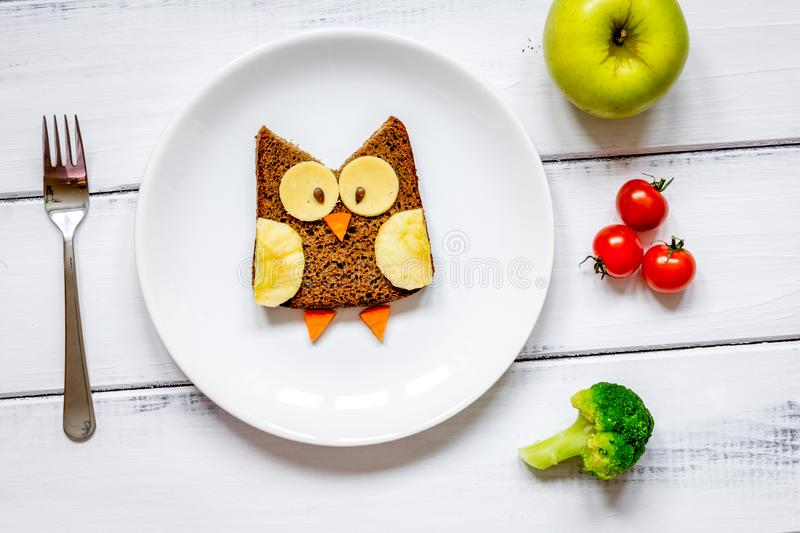 Kids menu owl shaped sandwich with vegetables and fruits stock photo