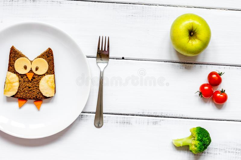 Kids menu owl shaped sandwich with vegetables and fruits stock images