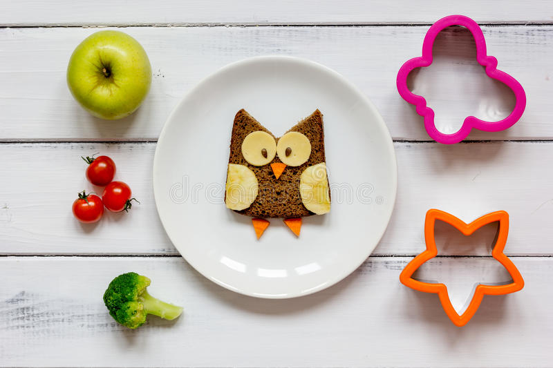 Kids menu owl shaped sandwich with vegetables and fruits royalty free stock photos
