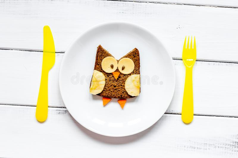 Kids menu owl shaped sandwich on white plate top view royalty free stock photos