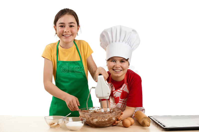 Kids mixing dough. Young girl and boy making sweet cakes isolated on white background stock photos