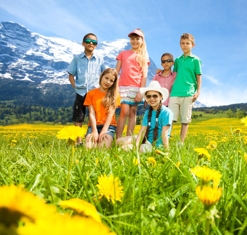 Kids in the mountains flower field stock photography