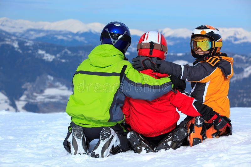 Kids on mountaintop snow stock images