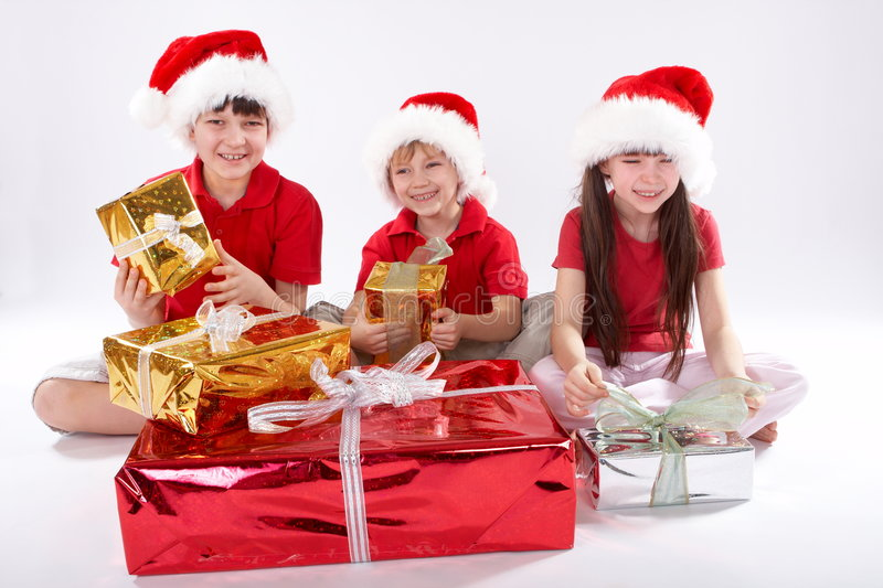 Download Kids Opening Christmas Gifts Royalty Free Stock Image - Image: 4145246