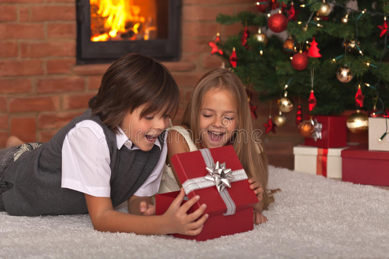 Kids opening their Christmas present royalty free stock photo