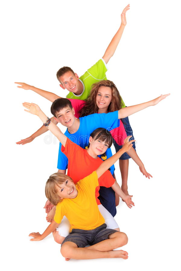 Kids with Outstretched Arms. Group of happy children and teens in a row behind each other with outstretched arms on white background royalty free stock photo