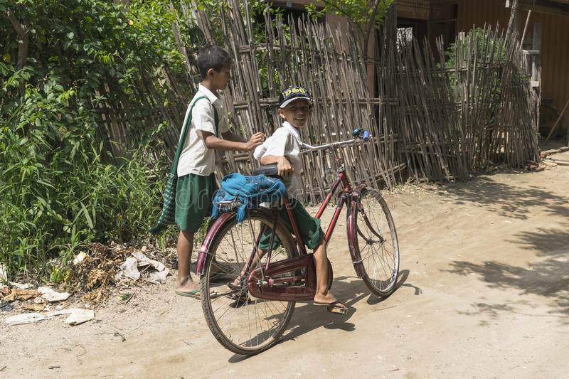 Kids in Pagan. Kids go to the home in the village in Pagan , Myanmar (Burma stock image