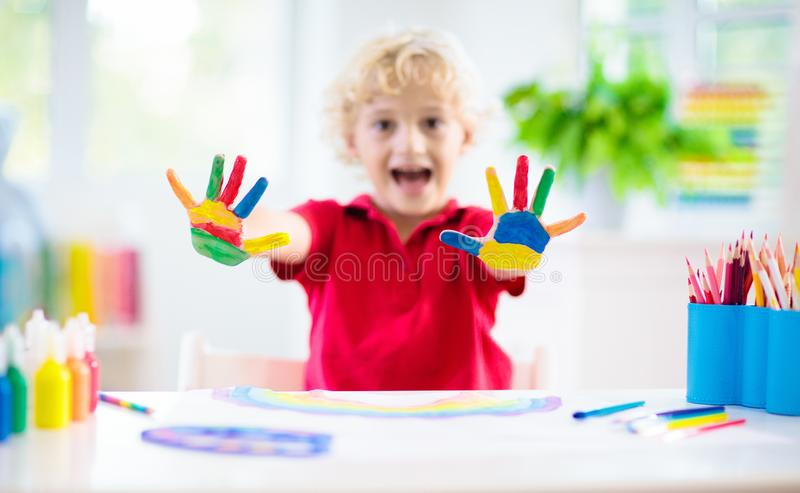 Kids paint. Child painting. Little boy drawing royalty free stock photos