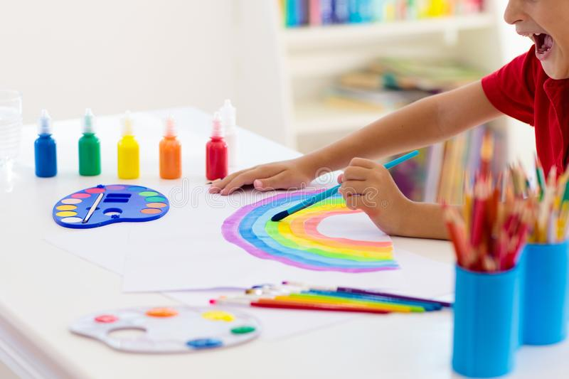 Kids paint. Child painting. Little boy drawing stock images