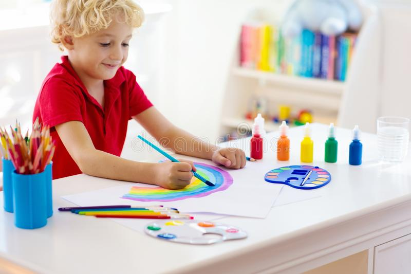 Kids paint. Child painting. Little boy drawing royalty free stock photo