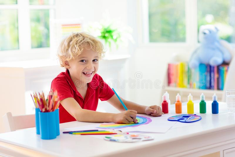 Kids paint. Child painting. Little boy drawing royalty free stock image