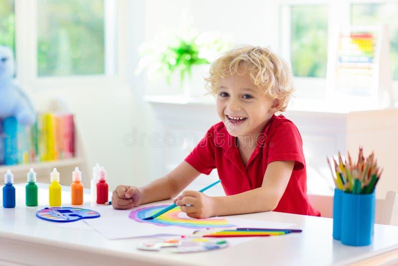 Kids paint. Child painting. Little boy drawing stock photo