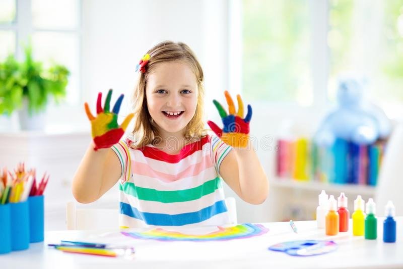 Kids paint. Child painting. Little girl drawing royalty free stock photos