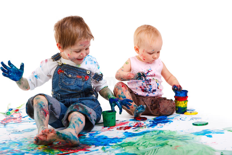 Kids painting. Cute 5 years old boy and toddler girl painting on white background stock images