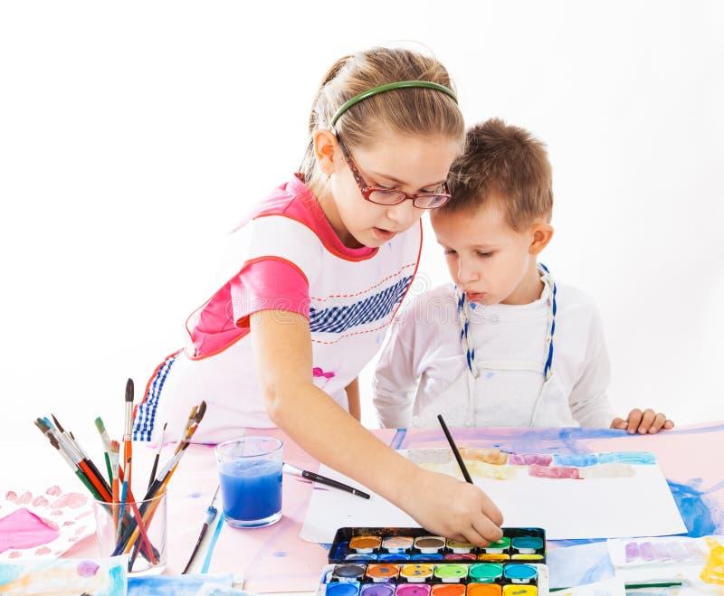 Kids painting royalty free stock photos