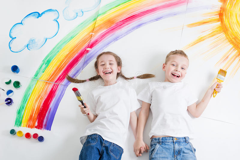 Kids painting rainbow royalty free stock images