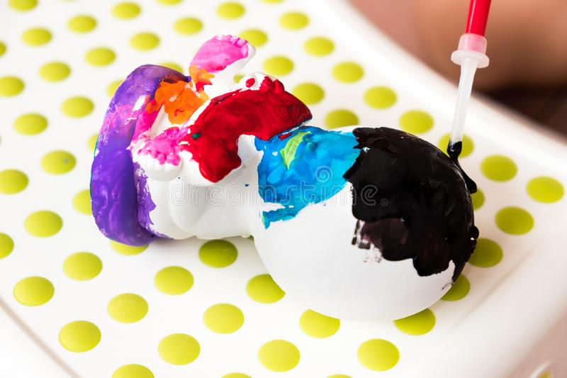 Kids is painting the sculpture with colorful color. it`s fun hob stock images