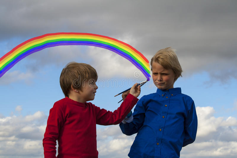 Kids painting in the sky stock photography