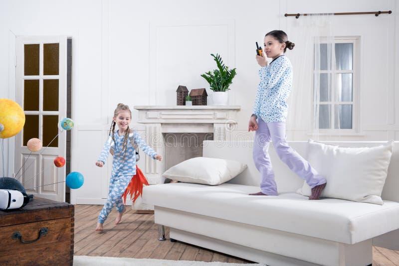 Kids in pajamas playing cosmonauts. At home stock photos