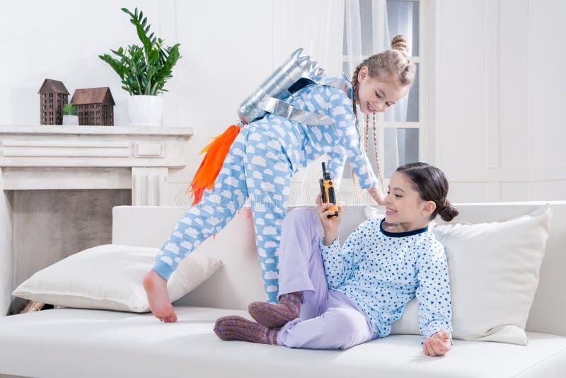 Kids in pajamas playing cosmonauts. At home stock photo