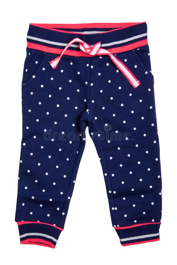 Kids pants isolated. A stylish fashionable dark blue denim trousers with white dots for the little girl. Children sport trousers stock image